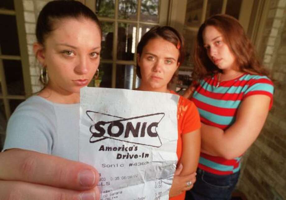 """Then-20-year-old Cori Lopez, far right, says she and friends Leslie Rickie, left, and Emily Demmler were innocent customers at a Sonic drive-in. She called their arrests """"dehumanizing."""" Photo: Ben DeSoto, CHRONICLE FILE"""