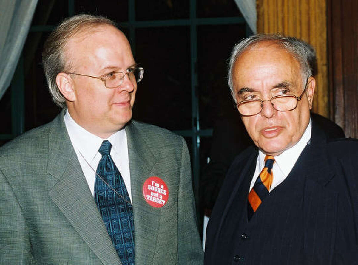 Karl Rove and Robert Novak appear at a party to mark an anniversary of the start of Novak's column.