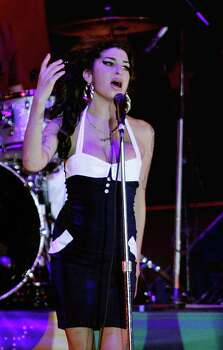 FILE- In this Jan. 15, 2011 file photo, British singer Amy Winehouse performs in concert in Sao Paulo, Brazil. The singer was found dead Saturday, July 23, 2011, by ambulance crews who were called to her home in north London's Camden area. She was 27.(AP Photo/Nelson Antoine, File) Photo: Nelson Antoine, STR / AP