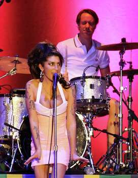 FILE - In this Jan. 8, 2011 file photo, British artist Amy Winehouse performs during her show in Florianopolis, Brazil. The singer was found dead Saturday, July 23, 2011, by ambulance crews who were called to her home in north London's Camden area. She was 27.  (AP Photo/Nabor Goulart, File) Photo: Nabor Goulart, STR / AP