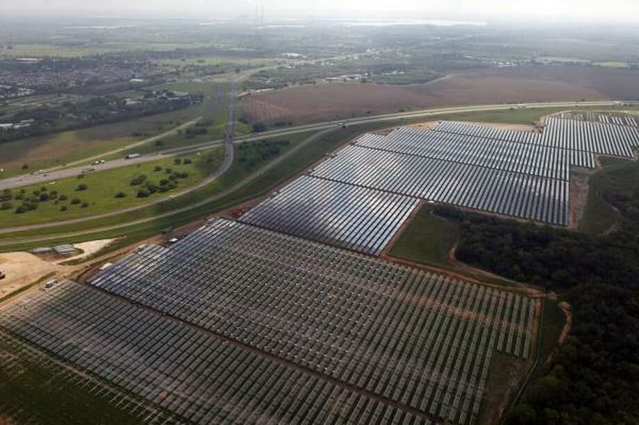 Texas' first solar farm is in southeastern San Antonio, dubbed Blue Wing. It has an array of 215,000 photovoltaic panels that capture sun rays and turn them into power. Photo: Lisa Krantz :, San Antonio Express-News