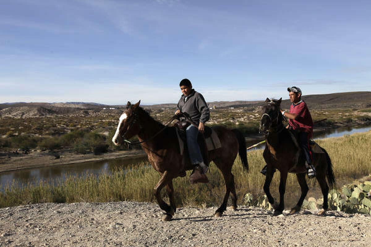 Children on horseback ride Thursday along the Rio Grande at Boquillas Del Carmen. Construction at a border crossing in the area will begin this summer.