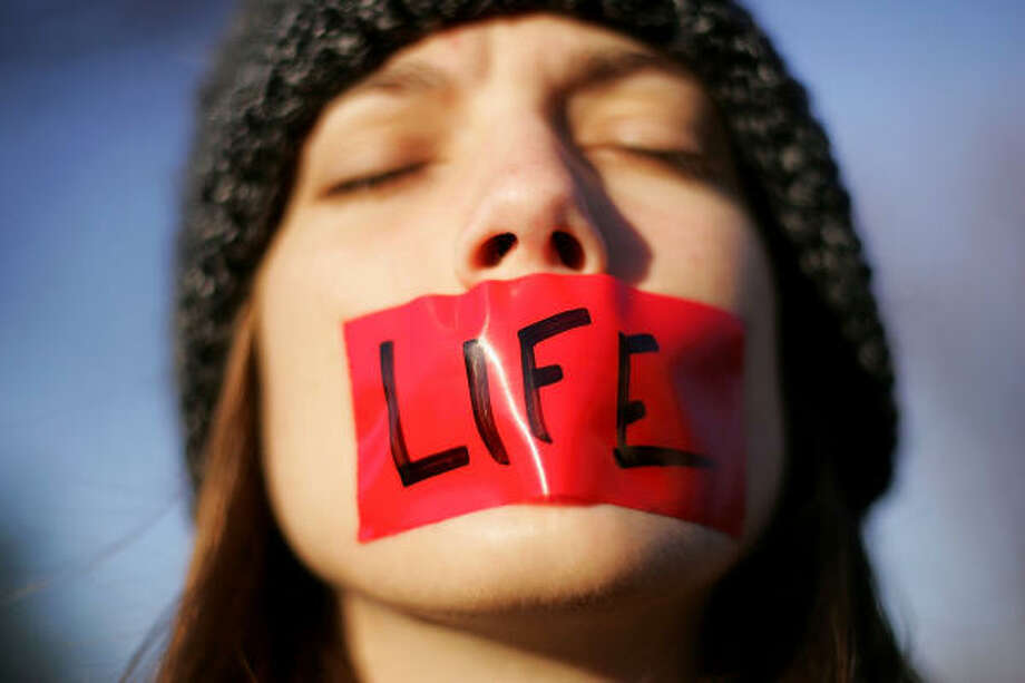 Lynn Jackson, with the group Bound4LIFE, protests in front of the U.S. Supreme Court. Photo: Getty Images File