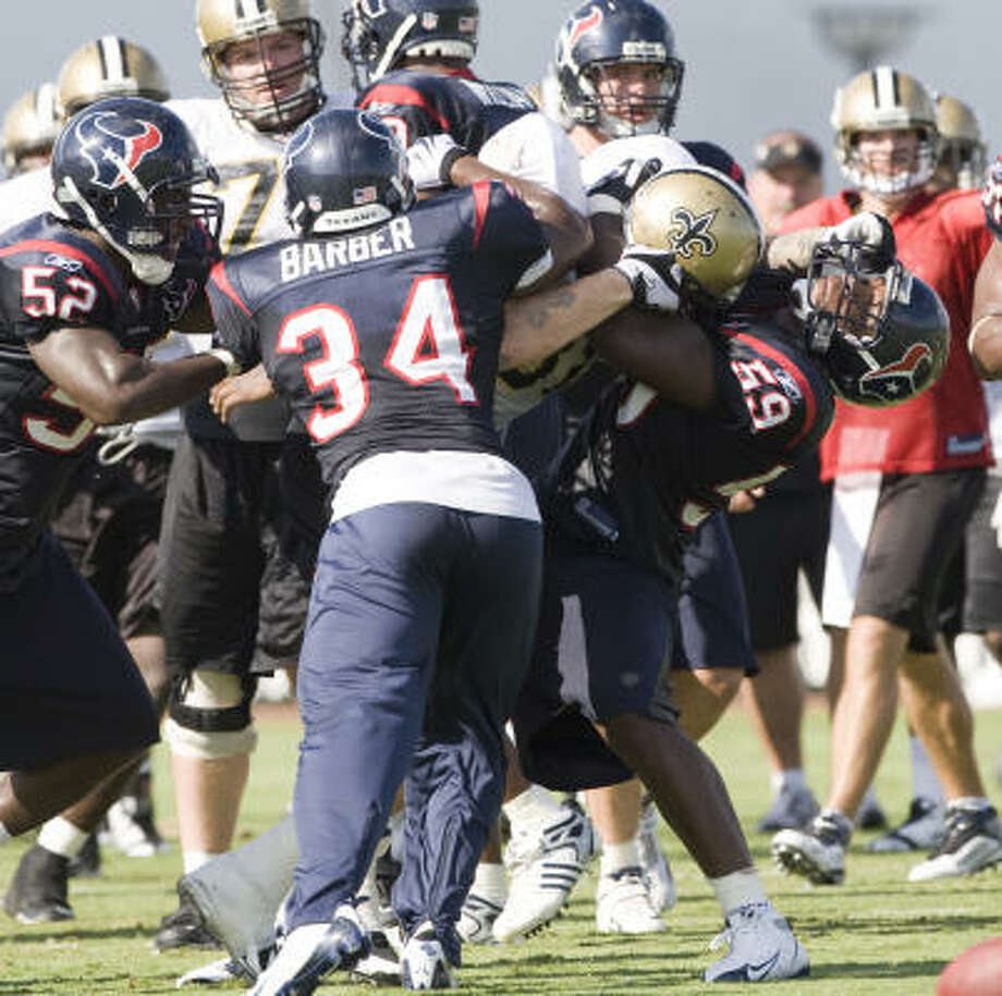 Texans linebacker DeMeco Ryans (59) gets into a fight with Saints tight end Jeremy Shockey on Thursday. The Texans wrapped up two-a-days by play-fighting with the Saints; tonight they play-play against them, writes Jerome Solomon. Photo: Brett Coomer, Chronicle