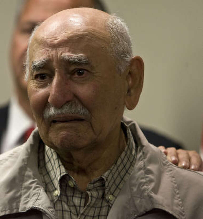 Jesus Canales, the father of Houston Police Officer Henry Canales, sheds tears after the verdict is returned. Photo: James Nielsen, Chronicle