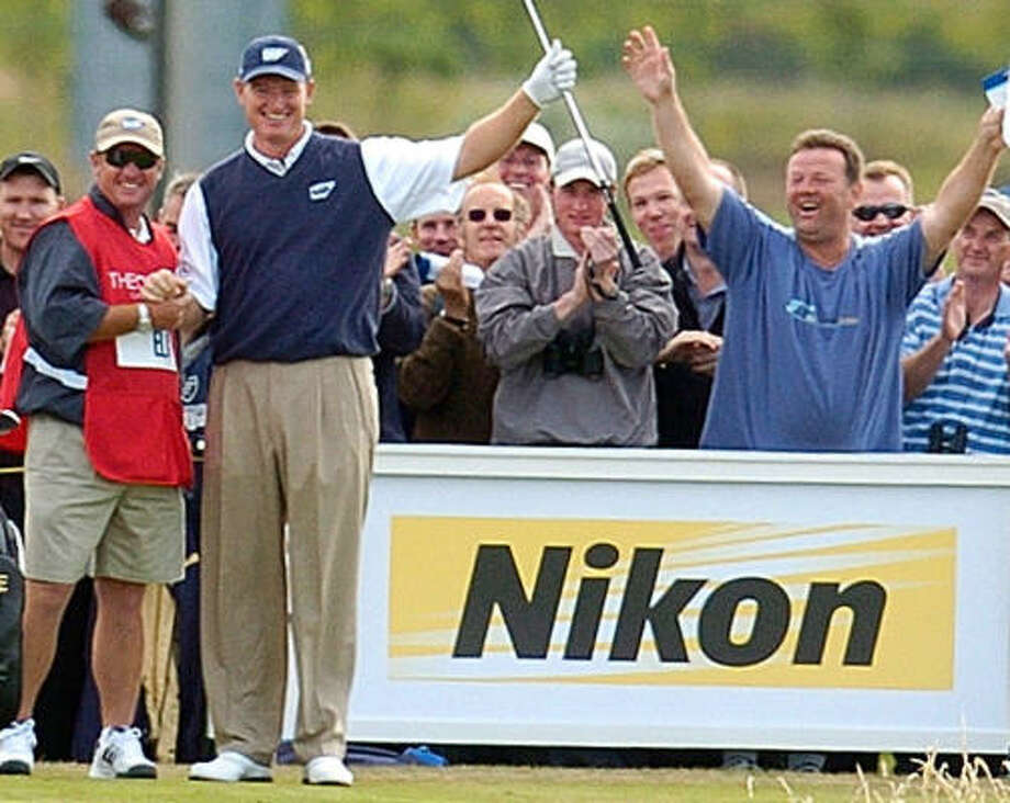 Ernie Els and his fans celebrate a 2004 hole-in-one at Troon. Photo: HUGH ROUTLEDGE, AP