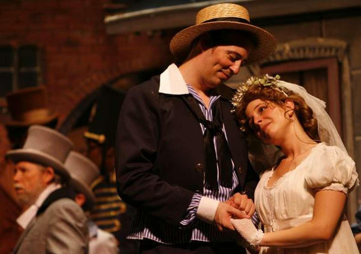 Richard Dauntless (Joshua La Force) and Rose Maybud (Alison Greene) share their happiness in the Gilbert & Sullivan Society of Houston production of Ruddygore.