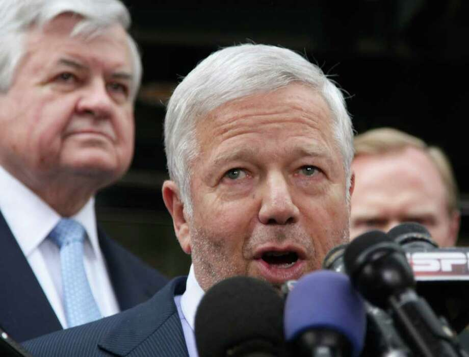 New England Patriots owner Robert Kraft, center, speaks during a news conference at the NFL Players Association in Washington, Monday, July 25, 2011, after the NFL Players Association executive board and 32 team reps voted unanimously Monday to approve the terms of a deal with owners to the end the 41/2-month lockout. At right is Carolina Panthers owner Jerry Richardson. (AP Photo/Carolyn Kaster) Photo: Carolyn Kaster
