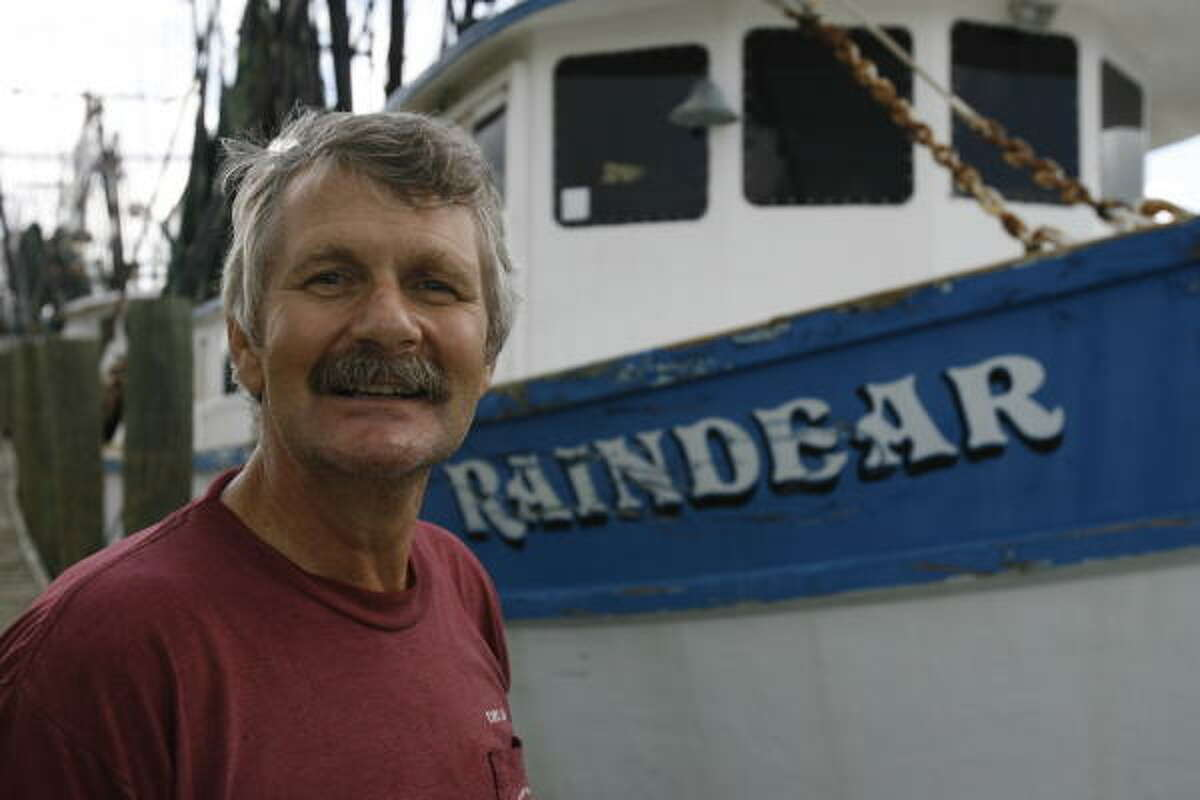Capt. Ed Kiesel, with his shrimp boat Raindear on Thursday in Freeport, delivered a baby named Brian Edward Mawhorr after the cook, Cindy Preisel, went into labor.