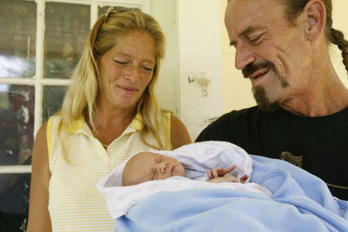 Cindy Preisel and Brian Keith Mawhorr hold their son, Brian Edward Mawhorr, Thursday in Oyster Creek.