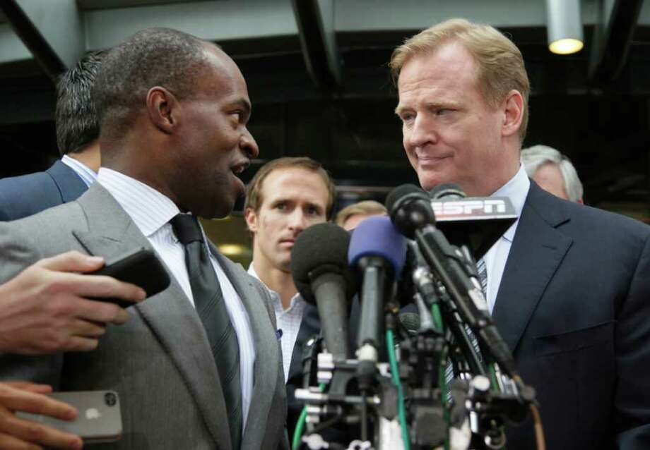 NFLPA Executive Director DeMaurice Smith, left, and NFL football Commissioner Roger Goodell take part in a news conference at the NFL Players Association in Washington, Monday, July 25, 2011, after the NFL Players Association executive board and 32 team reps voted unanimously to approve the terms of a deal with owners to the end the 41/2-month lockout.  (AP Photo/Carolyn Kaster) Photo: Carolyn Kaster