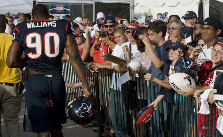 Mario Williams (90) has been a fan favorite at Texans camp this week. Photo: Brett Coomer, Chronicle