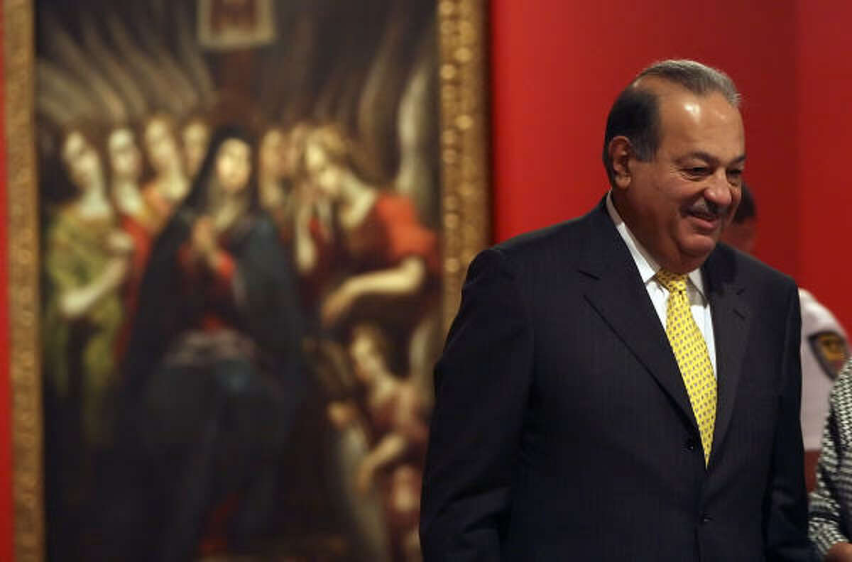 ART COLLECTOR: Mexican billionaire Carlos Slim answers questions Tuesday at the Museo Alameda in San Antonio, which is showing a portion of his vast art collection.