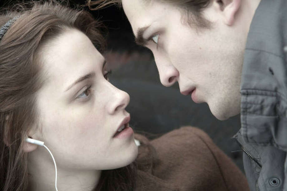 Edward's (Robert Pattinson) love for Bella (Kristen Stewart) outweighs his urge to bite her and suck her dry, thanks to a strong conscience and his coven?s unusual practice of abstaining from human blood. Photo: Peter Sorel