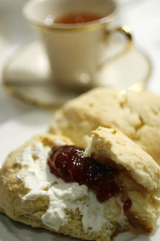 Slathered with clotted cream and strawberry preserves, this tender, cakelike golden scone is a snap to make with a couple of eggs and King Arthur Flour's Cream Tea Scone Mix. See Quick-Fix Scones below for more on mixes. Photo: SHARON STEINMANN PHOTOS :, CHRONICLE