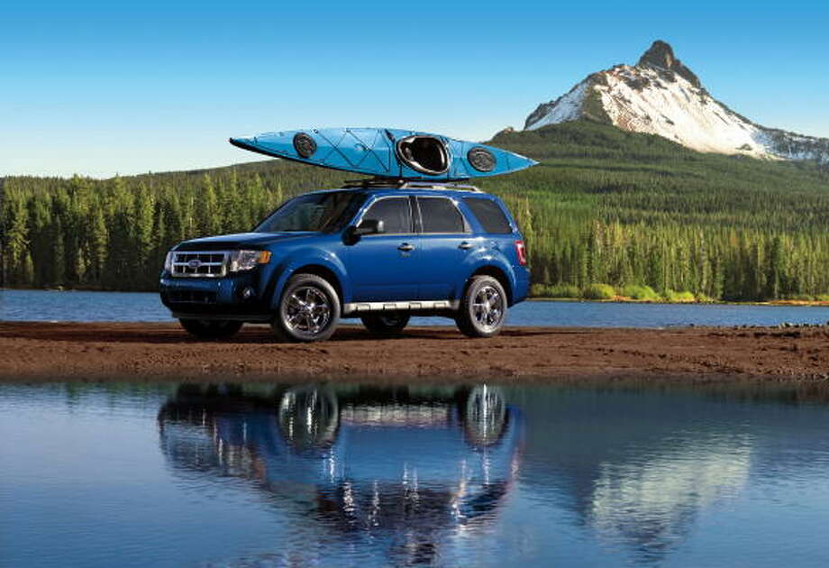 The 2009 Ford Escape Shown And Mercury Mariner Are Available With A New 2 5