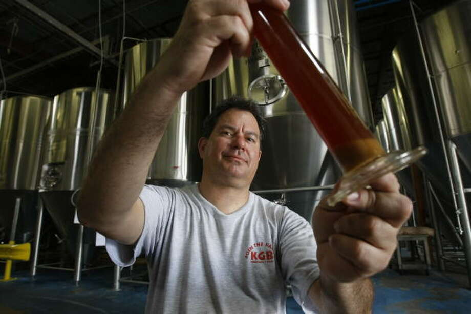 Phillip Kaufman displays wort, the liquid that is one step away from becoming beer as all it needs is yeast to become beer. Photo: Julio Cortez, Chronicle