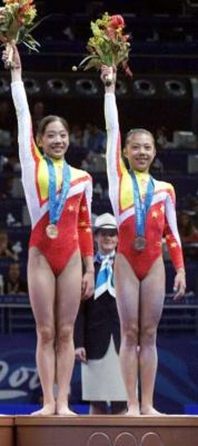 The International Olympic Committee determined Dong Fangxiao, right, was only 14 at the 2000 Sydney Olympics. Photo: AMY SANCETTA, AP