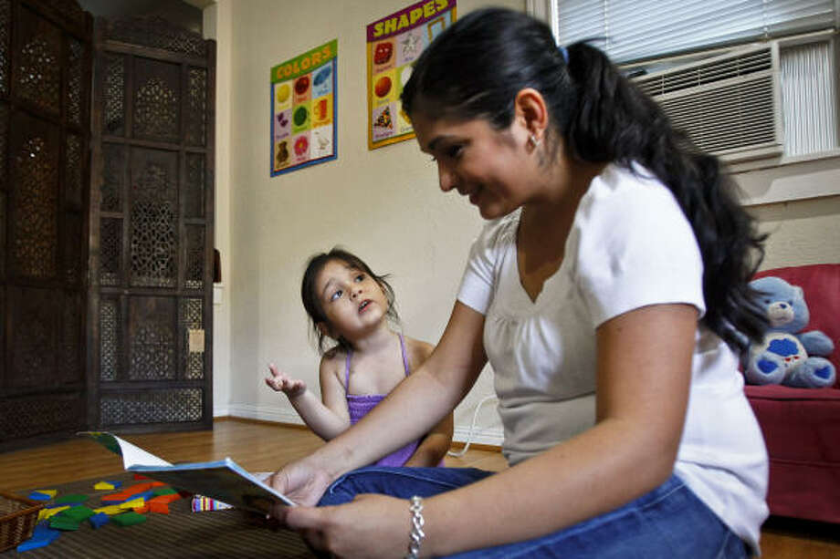 Angela Rangel reads a book to her home schooled daughter, Sophia, 3, at the family's home on Saturday. Photo: Michael Paulsen, Chronicle