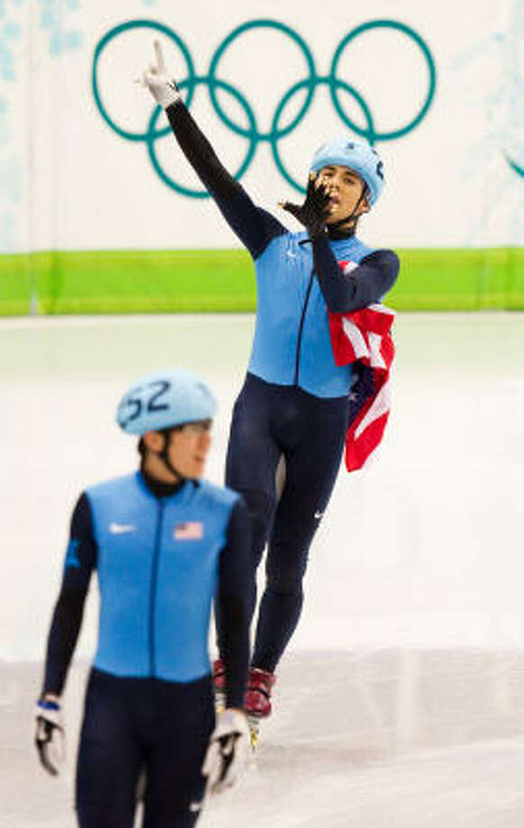 U.S. speedskater Apolo Anton Ohno holds up six fingers to signify his sixth olympic medal after finishing second in the 1,500. Photo: Smiley N. Pool, Chronicle Olympic Bureau
