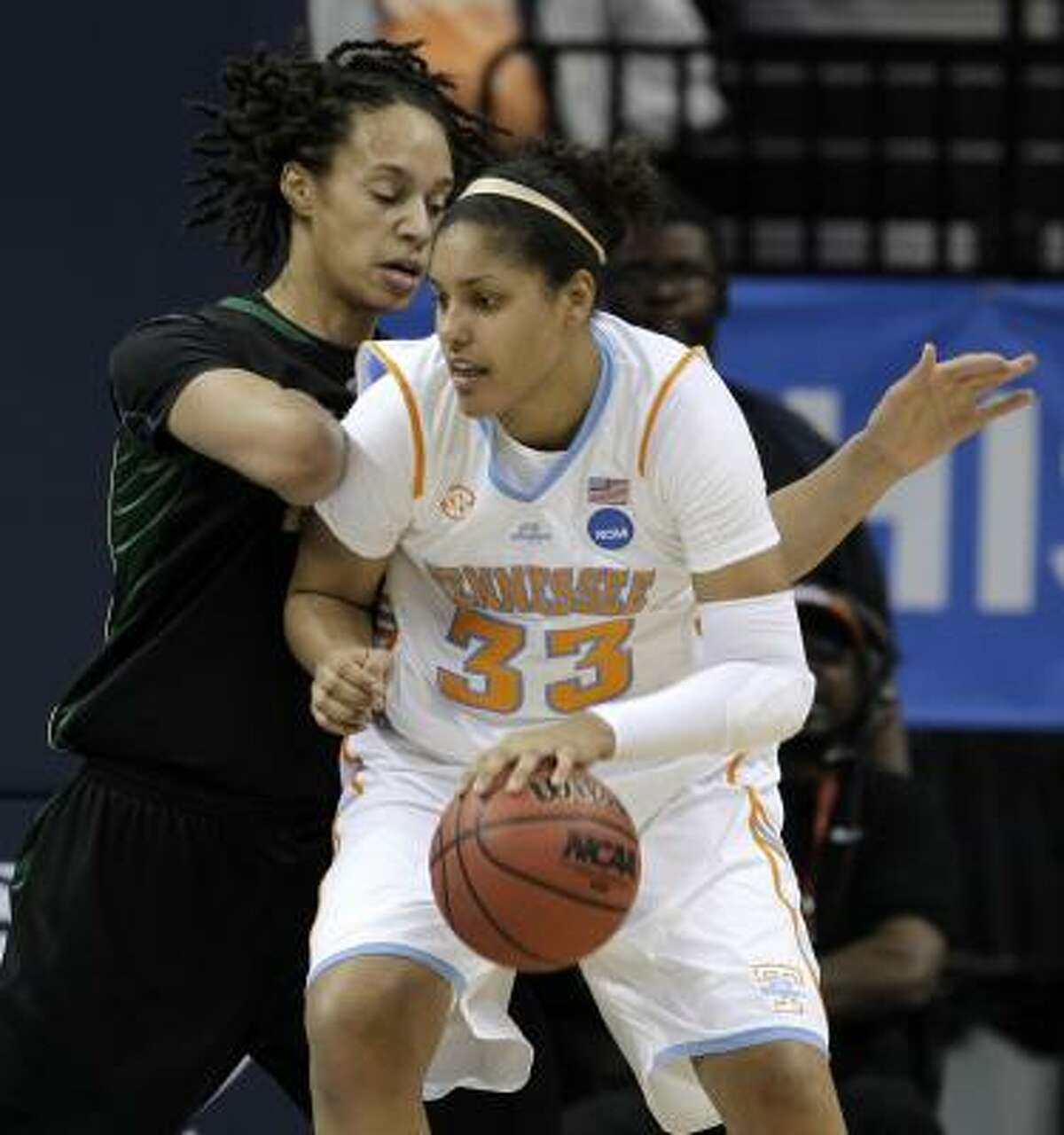 The size of 6-8 Baylor center Brittney Griner, left, proved to be too much for Tennessee and Alyssia Brewer during the Lady Bears win in the Sweet 16.