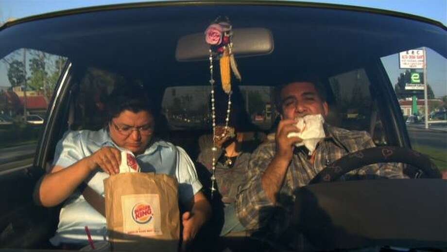 The Orozcos dine in their car after visiting a fast-food restaurant in Food, Inc. Photo: MAGNOLIA PICTURES