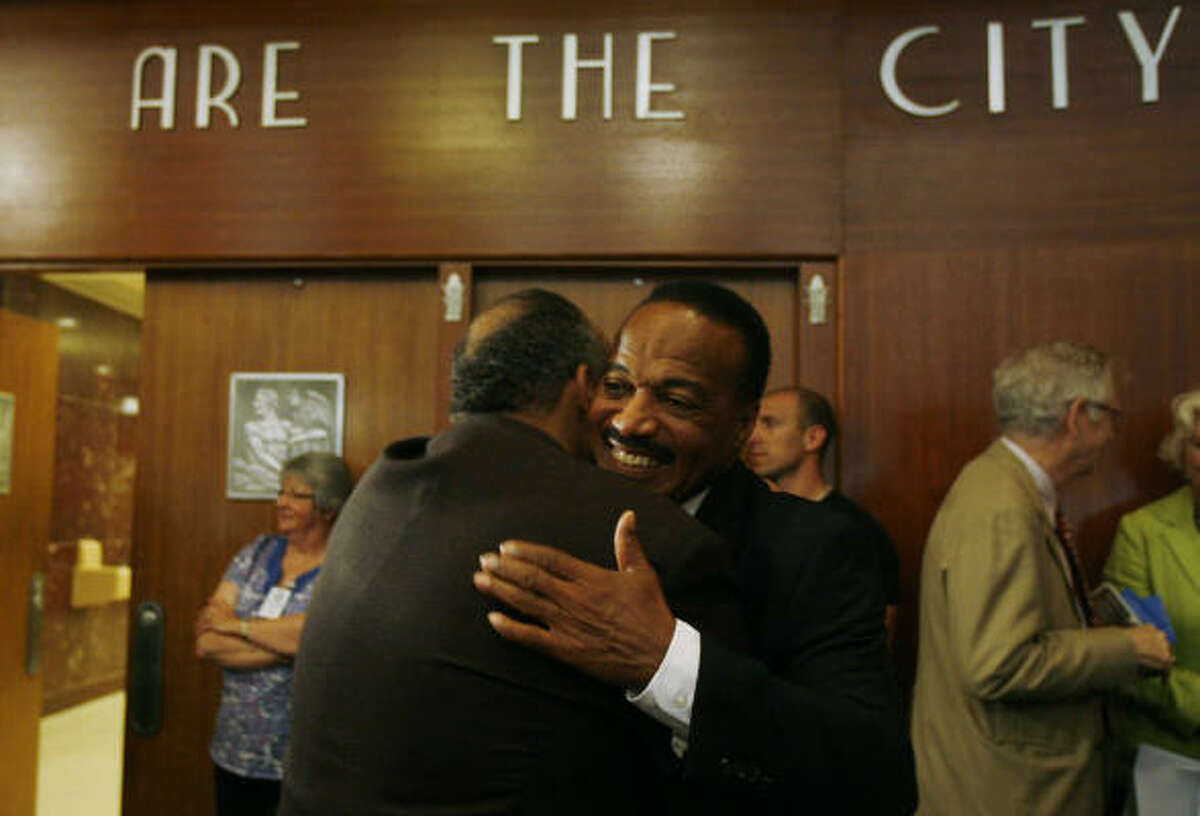 Jerry LeVias, right, catches up with former high school teammate George Vallery at City Hall. Tuesday was declared Jerry LeVias Day by Mayor Annise Parker.