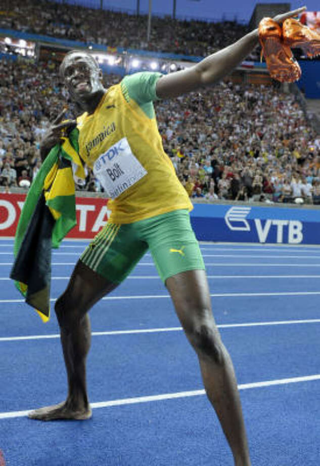 After the 6-5 Bolt unfolds those gangly legs he runs at a top speed that, aside from animals, hasn't been matched by anything on this planet that didn't have a motor attached to it. Photo: MICHAEL KAPPELER, AFP/Getty Images