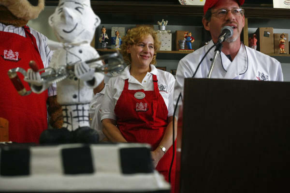 Janice Jucker and her husband, Robert Jucker, celebrate the grand reopening celebration of Three Brothers Bakery in July after Hurricane Ike closed it down.