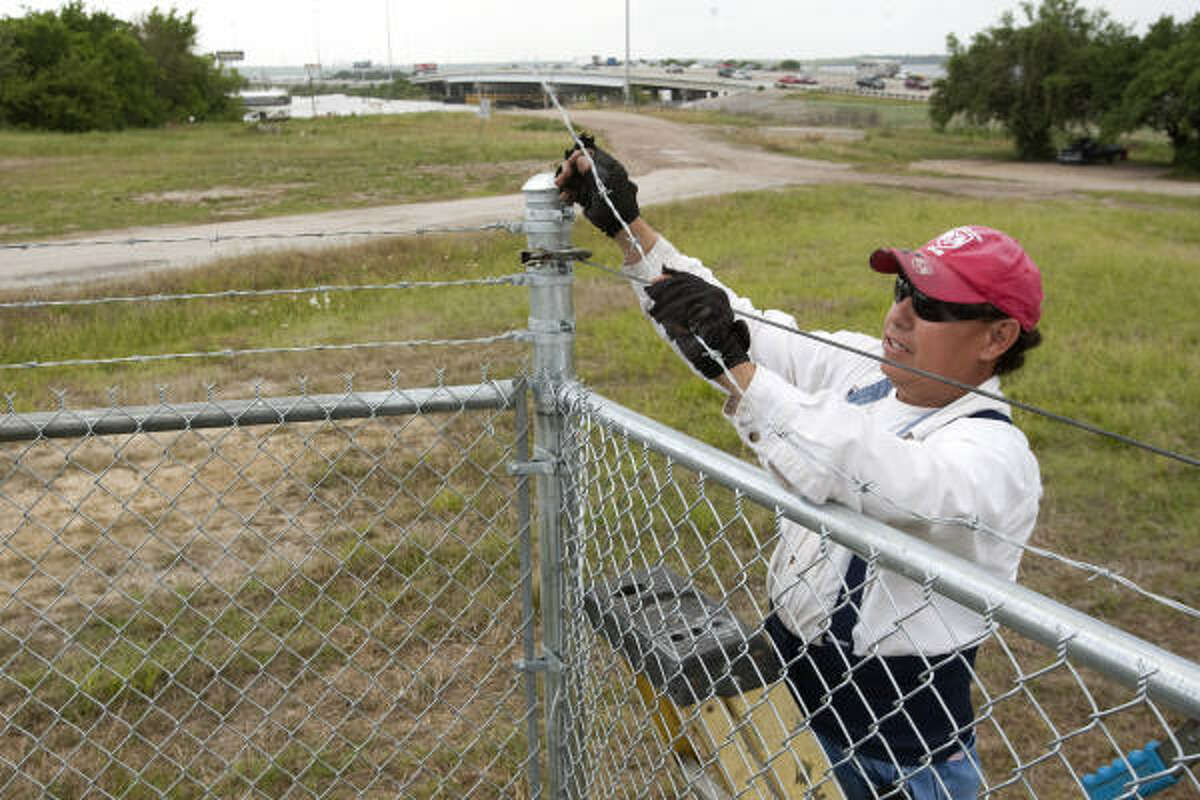 The Environmental Protection Agency is installing fencing to keep fishermen away from the San Jacinto River waste pits, a Superfund site.