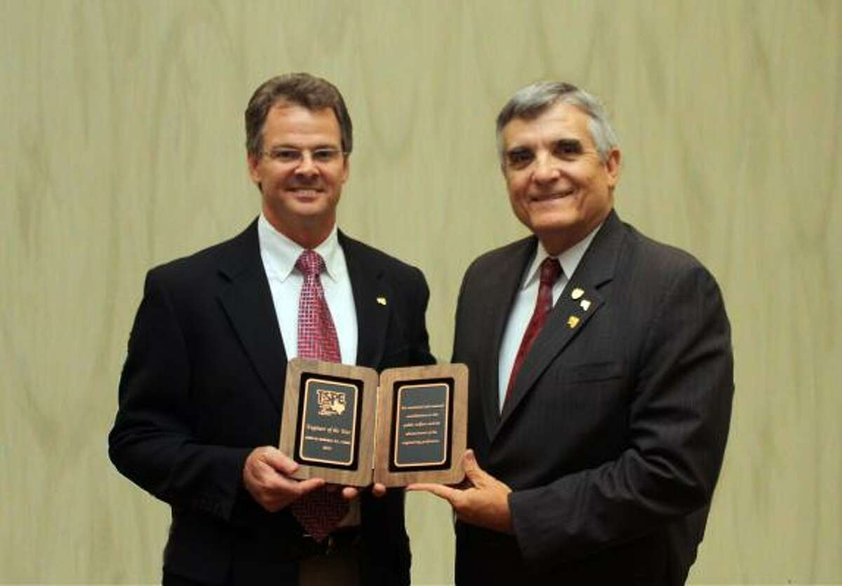 Larry M. Barfield, right, receives his 2010 Engineer of the Year award from Texas Society of Professional Engineers president Kent O'Brien.