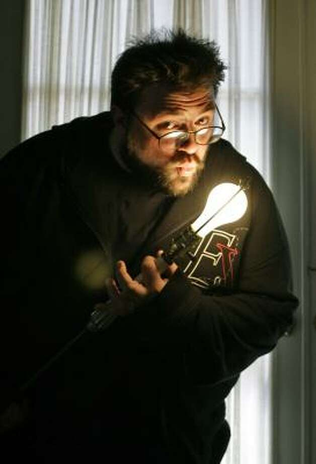 """Although his movies are full of colorful language, Kevin Smith said his childhood was the opposite. """"I grew up in a house,"""" Smith says, """"where Mom wouldn't curse; she'd say 'H-E-double hockey sticks.' Which is a long way of saying hell, right? I guess you are a product of your environment."""" Photo: Erich Schlegel, For The Chronicle"""