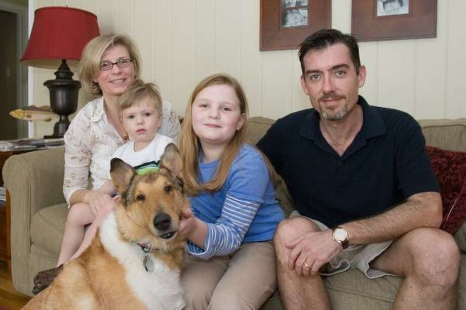 Justin Cronin, pictured with his family Leslie, from left, Atticus, Tod the dog and Iris, signed a $3.75 million deal with Ballantine to write a post-apocalyptic vampire trilogy. Photo: R. CLAYTON McKEE, FOR THE CHRONICLE