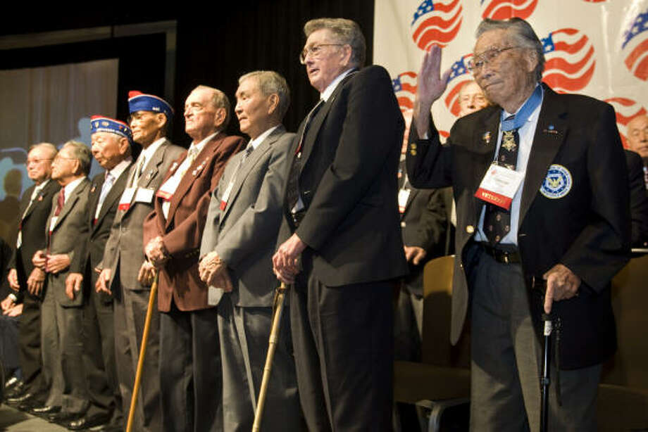 "Medal of Honor winner George Sakato, right, was reunited in Houston Sunday with the ""Lost Battalion"" and the other Japanese-American soldiers who rescued them from behind Nazi lines.  Photo: Brett Coomer, Chronicle"