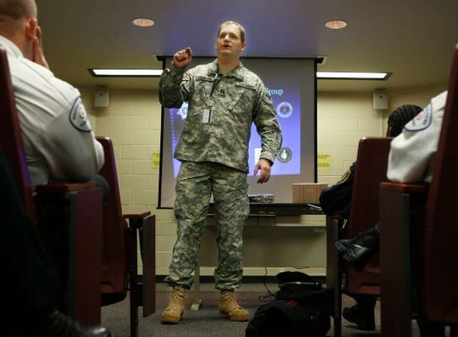 Capt. Michael Liesmann teaches officers how to spot and report suspicious behavior that could be terrorism. The Operation Warfighter initiative helped him get a job with the FBI after he injured his eye in Iraq. Photo: KEVIN FUJII, CHRONICLE