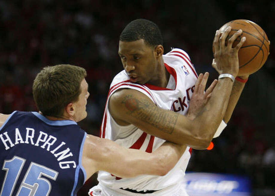Rockets guard Tracy McGrady (1) prepares to drive the ball against Utah Jazz forward Matt Harpring. Photo: James Nielsen, Chronicle