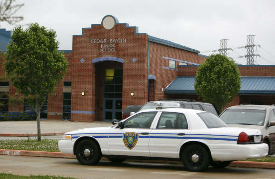 A Goose Creek school district patrol car sits in front of Cedar Bayou Junior School, where a 14-year-old girl gave birth to a full-term baby on April 2 and apparently drowned the baby in a toilet. Photo: Karen Warren, Chronicle