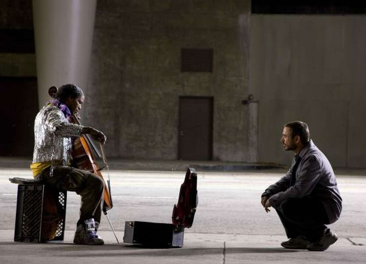 Jamie Foxx, left, portrays a schizophrenic Juilliard-trained cellist, and Robert Downey Jr. portrays a Los Angeles Times columnist in The Soloist.