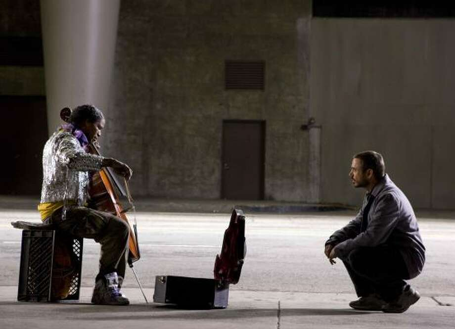 Jamie Foxx, left, portrays a schizophrenic Juilliard-trained cellist, and Robert Downey Jr. portrays a Los Angeles Times columnist in The Soloist. Photo: Francois Duhamel, Paramount Pictures | DreamWorks