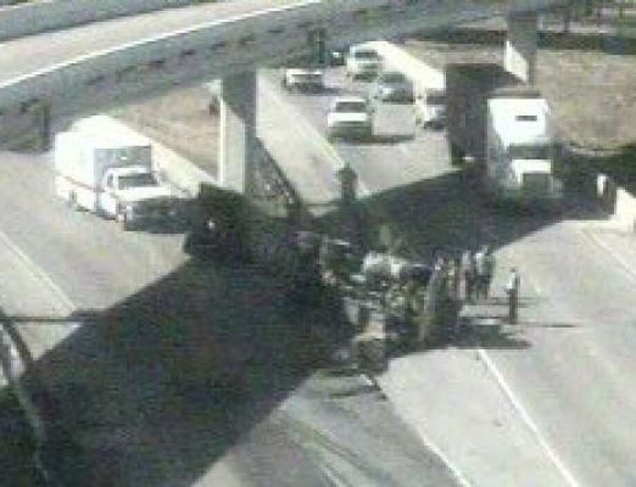 A tanker truck overturned at the intersection of Interstate 45 and the 610 South Loop late this morning. Photo: Houston TranStar