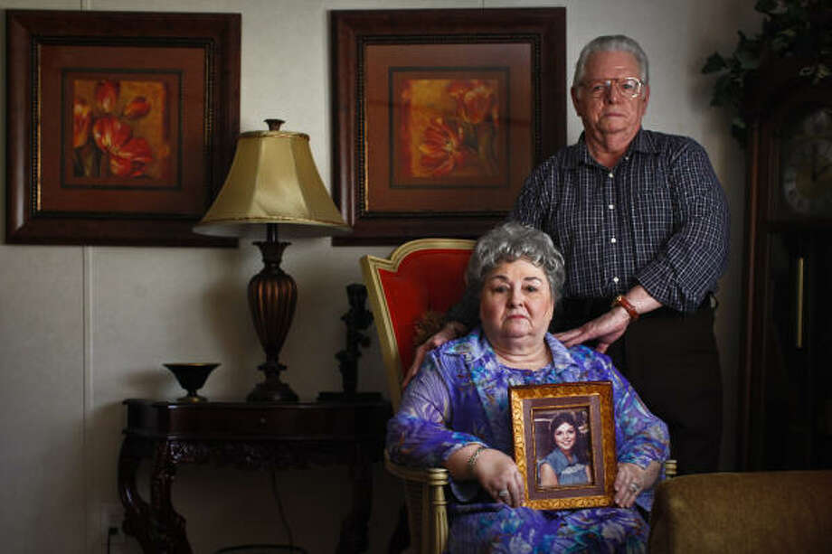 Maxine and Darwin Patton hold a photo of their daughter Judy Maxine Patton, whose death in north Houston 30 years ago remains unsolved. Photo: Michael Paulsen, Houston Chronicle