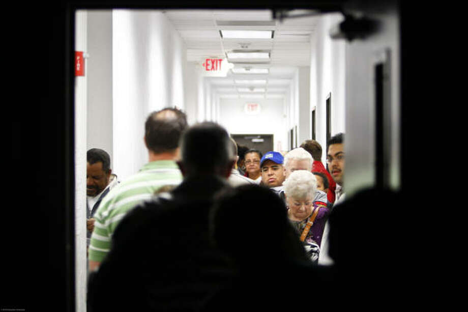 Voters from Precinct 618 gather at the Harris County Pocket Park and Offices, to vote during Election Day in Katy. Photo: Michael Paulsen, Houston Chronicle