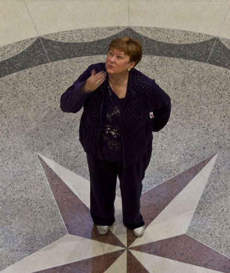 "Beverly Kaufman blows a kiss to a friend Wednesday on her last day of work as Harris County Clerk. After nearly 17 years, she's set her sights elsewhere. ""I don't want to go with my boots on,"" Kaufman said. Photo: Nick De La Torre, Chronicle"