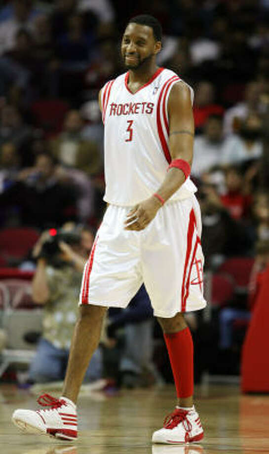 For weeks Tracy McGrady has said he was ready to go, but the Rockets have said he wasn't. Photo: Billy Smith II, Chronicle
