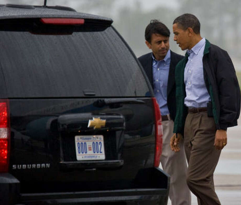 Louisiana Gov. Bobby Jindal, left, with President Barack Obama at the airport in New Orleans on Sunday. Photo: Melissa Phillip, Chronicle