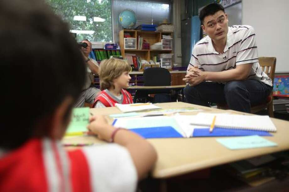 Yao Ming answers questions in a first-grade classroom during his visit to Hunters Creek Elementary. Photo: Mayra Beltran, Chronicle