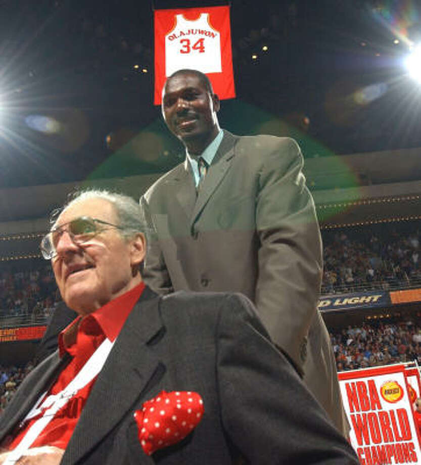 Guy Lewis joins Hakeem Olajuwon, one of three of the NBA's 50 greatest players Lewis coached, during a 2002 ceremony in which the Rockets honored Olajuwon. Photo: KAREN WARREN, CHRONICLE