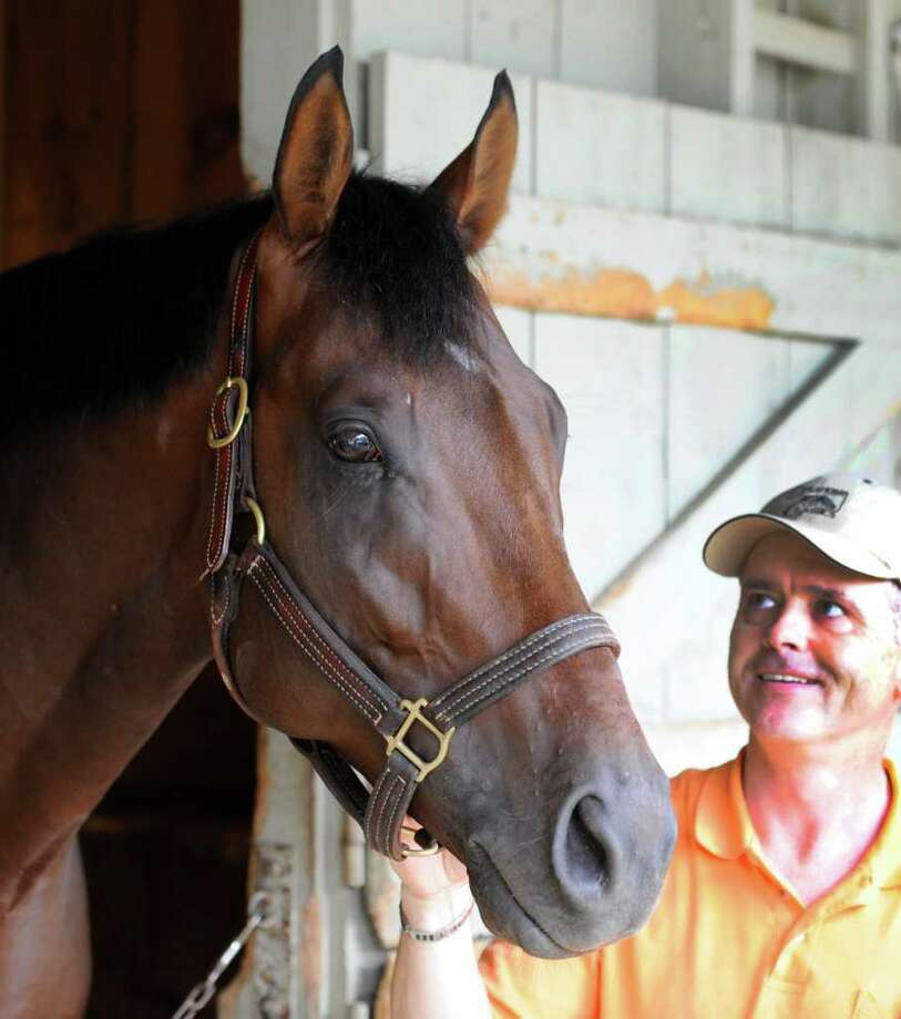Trainer Don Von Hemel with his Jim Dandy Stakes entry Alternation in the barn area of the Oklahoma Training center in Saratoga Springs, N.Y. July 25, 2011.  (Skip Dickstein / Times Union) Photo: SKIP DICKSTEIN