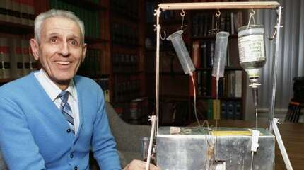 In this 1991 photo, Dr. Jack Kevorkian poses with a machine he invented to administer fatal drugs to patients. After more than eight years in prison, Kevorkian will be released June 1.