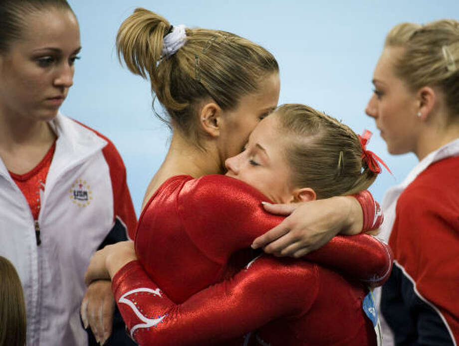 U.S. gymnast Shawn Johnson, right, hugs teammates Alicia Sacramone after competing on the floor exercise during the women's gymnastics team final at the 2008 Summer Olympic Games on Wednesday. Photo: Smiley N. Pool, Chronicle